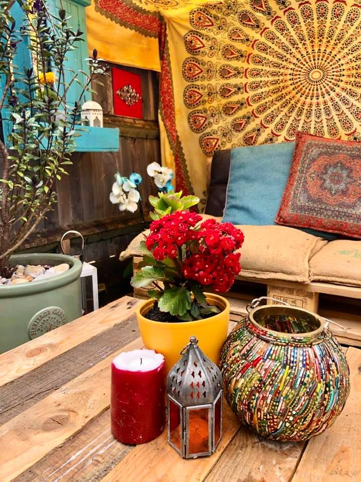 """""""Garden upcycling patio blog"""" pallet table, candles, flowers and lanterns by Emma Mullender"""